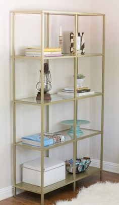 Brilliant DIY Gold Spray Paint Projects To Turn Trash Into Luxury - The ART in LIFE Glass Bookshelves, Bookshelves In Living Room, Ikea Bookcase, Bookshelf Diy, Glass Shelves, Ikea Hacks, Gold Shelves, My New Room, Home Interior