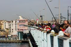 Fishermen on the Galata Bridge wait patiently for a nibble at the end of their line.
