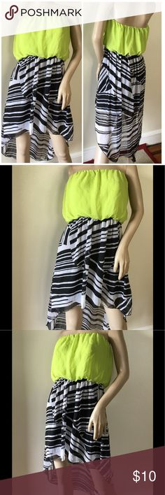 """Lime/Black White High Low Hem Summer Travel Dress Juniors Lime/Black White Sexy High Low Hem Striped Summer Travel Dress Item never was used or wore, no rips,steins, threads or any defects tags are missing,  Pair with strappy sandals, a stylish floppy hat for a ready for anything look!  Featuring a two tone striped sheer chiffon high low hem skirt, Color block lime strapless bodice, Slip on, and finished with a loose fit. Fully lined, light weight.  MESURES: Low hem 25"""" ; Long hem 36""""…"""