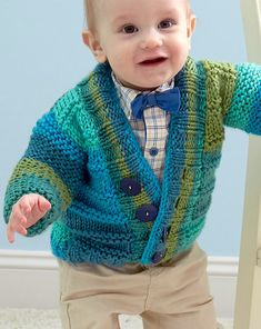 Free Knitting Pattern for Soft Essentials Baby Cardigan - This classic baby cardigan gets its stripes from self-striping yarn. Sizes 6 months, 12 months, 18 months, 24 months. Designed by Sara Kay Hartmann for Red Heart. Quick knit in bulky yarn.