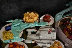 Stage a Klingon Attack Cruiser defending the Enterprise from a Romulan Warbird over the food table at a Star Trek: The Next Generation party