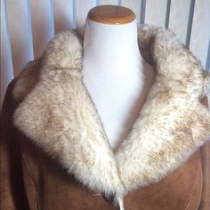 """Long Suede Coat Very warm, fur lined, long suede coat by Wilsons Leather!  Three button closure, soft fur collar, fur trim around bottom of sleeves.  Two side pockets. Heavy, warm coat! Measurements Bust 22"""", Sleeves 22"""", Hips 22"""", Length 45"""" Never Worn Wilsons Leather Jackets & Coats Trench Coats"""