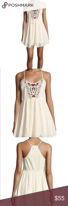 Band of Gypsies babydoll dress Size M but runs small imo. NWT. 100% cotton floral embroidered babydoll dress. Cream / ivory color. Asymmetrical hem, lined skirt. Perfect summer dress. Actual pic to be updated* Band of Gypsies Dresses Mini