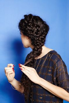"""4 DIY Braided 'Dos For Curly Girls #refinery29  http://www.refinery29.com/56118#slide-20  Once you're happy with the look, pin the ends into the main braid. """"You want to keep this whole look loose,"""" says Brill. """"This isn't a tightly-wound braid — it's kind of a Wild West look."""""""