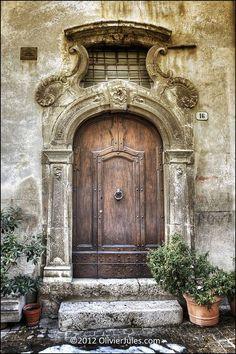 Ornate stone surround. Vintage antique wood door.