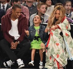 Blue Ivy, Dad Jay Z, Mom Beyoncé at court side during NBA All Star Game 2017