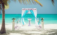 With the backdrop of bright turquoise ocean, alongside green lush palm trees and blue sky, turquoise color looks more vivid, bright and luxurious. Paired with deep purple shades, and complete the decor with crystal elements throughout and you have a stunning beach wedding in Punta Cana.