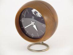 Mid-century modern George Nelson Design Desk Clock for Howard Miller, circa 1959. USA. Walnut wood, metal & glass (www.1stdibs.com)