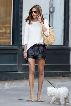 Olivia Palermo with her dog Mr Butler. White shirt and black leather shorts