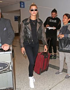 Touchdown! Hailey Baldwin proved she has an edgy side too as she arrived in Los Angeles on Wednesday