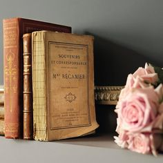 old books and pink roses