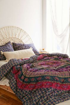 i love super colorful comforters with white walls. This comforter looks especially cozy i love it