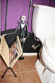My Nightmare Before Christmas bathroom. My hubby painted the walls and the rest is my collection of over 10yrs!  Jack Skelington magazine rack! <3