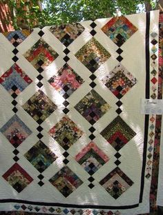 """Beautuful quilt pattern in Japanese fabric. The blocks are made with 2 1/2"""" strips or save a bit of time using jelly roll strips"""