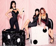 Roll the dice: Part of the shoot saw the sisters showing off their famous curves in more of their figure-hugging designs for Lipsy, while posing on giant fluffy dice