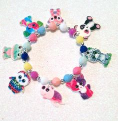 Our handmade bracelets feature beautiful faceted plastic beads with 8 homemade plastic charms strung on strong stretch elastic. The bracelet
