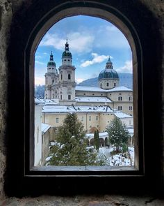 "@live_life_love_travel on Instagram: ""Salzburg Cathedral framed through a window in the catacombs of St. Peter's Cemetary."""