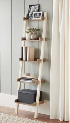 A leaning bookcase that will display your lifetime collection of prized books intermingled with accents to create a cozy reading corner. 28 Surprisingly Attractive Pieces Of Decor You Can Get At Walmart White Ladder Shelf, Ladder Shelf Decor, Narrow Shelves, Ladder Shelves, Shelf Display, Diy Home Decor On A Budget, Cute Home Decor, Rustic Bookshelf, Bookshelves