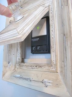 """Great idea to Cover garage door, security, AC, etc but maybe use a magnetic """"push and pop"""" instead of a knob so people will just think it's art and won't touch or fiddle."""