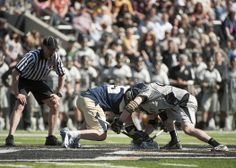 Army and Navy battle for possession of the ball.