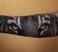 Tiger eyes tattoo