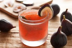 This cocktail recipe uses fresh figs, vodka, lemon juice, St-Germain elderflower liqueur, and agave nectar.