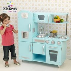 I used to love my play kitchen when I was little! :)  I need to get one for my little Emilia. :)