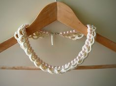 very chique pearl neclace with white cotton crochet-jacket