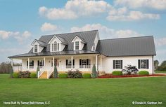 The Hollandale house plan 1140 built by Tanner Built Homes, LLC! This four-bedroom country house plan defines casual elegance with its front and back wrapping porches and triplet of dormers. An open, two-level foyer with palladian window leads to the expansive great room with cathedral ceiling. Windows all around and bays in the master suite and breakfast area of this house plan add space and light, while nine-foot ceilings create more volume. #wedesigndreams #countryhouseplan Palladian Window, Gambrel Roof, Contemporary Cottage, Country House Plans, Cozy House, Great Rooms, Floor Plans, Farmhouse, House Styles