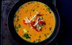 <p>This simple recipe is proof that you don't need to have a hundred different layers of flavor to make a recipe that's delicious. The curry is made from a base of coconut milk and Thai red curry paste with turmeric and served with roasted red peppers and yellow squash. </p>