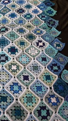 Crocheted granny squares with raise border edgings
