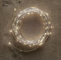 Starry String Lights - Diamond Lights on Silver Wire  http://www.restorationhardware.com/catalog/product/product.jsp?productId=prod1730031