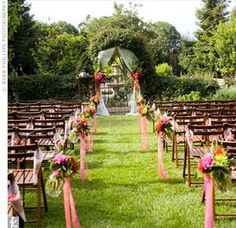 An open field overlooking an enclosed garden served as the ceremony site.