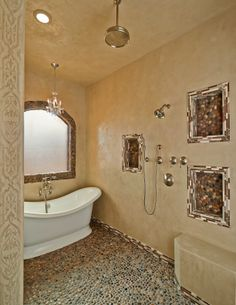An entire walk-in shower and bath in Marmorino-The arched radius entry w/ an embedded model pattern