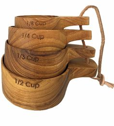 Sustainable Teak Measuring Cups -- Our sustainable teak measuring cup set includes 1/8 cup, 1/4 cup, 1/3 cup and 1/2 cup measurements. Teak is an extremely durable and beautiful wood. Our teak measuring cups are handcrafted by artisans from the excess material that the logging industry leaves behind so no new trees are cut down to create our products.