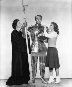 Myrna Loy and Shirley Temple with knight-in-shining-armor Cary Grant in a still for THE BACHELOR AND THE BOBBY-SOXER: