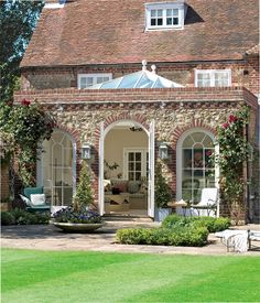 The perfect Orangery .love,love,love The original brickwork to match main house  Graceful orangery designed to order and painted in Marston & Langinger's (Prices on application. 020 7881 5700 www.marston-and-langinger.com) PERFECT i think for the build look from the end of rear garden to our build walking into the orangery - adding flint work to the existing flint and keeping in with the style of house?