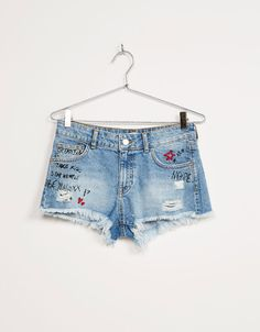 BSK embroidered denim shorts with text. Discover this and many more items in…