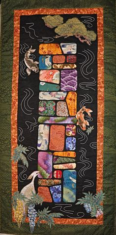 This is a quilted wall hanging appliqued with Asian inspired fabrics and continuing the Eastern motif with creative thread-play in the style of Japanese quilting.  (2010)