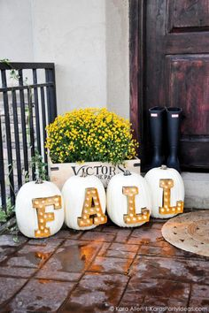 "These cheerful pumpkins were made to be in the spotlight. Spell out ""fall"" using marquee light letters on pumpkins displayed near your front door. See more at Kara's Party Ideas."