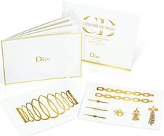 French fashion house Dior has created a line of limited edition temporary tattoos made of 24-carat gold.   Designed by Dior jewelry designer Camille Miceli, the 'Grand Bal' Golden Tattoos come in shapes of cuffs, chains, bracelets, charms and rings.