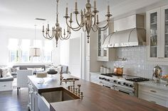 Bright and elegant kitchen. Love the banquette seating. By Tim Clarke, Interior Designer in Santa Monica, California
