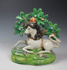 English Staffordshire pottery figures of the Lion and the Unicorn. Walton c1820