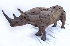 Rhino Driftwood Sculpture - see more of this talented artists work at http://www.phasesafrica.com