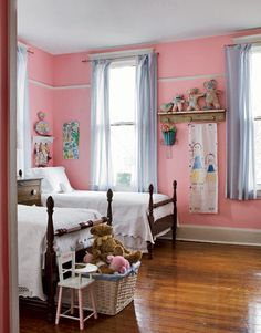 Pink Girl's Bedroom:   Abigail's room is hot pink; it has twin beds from Billy's great-grandmother's house and seersucker curtains. Billy Reid Designer
