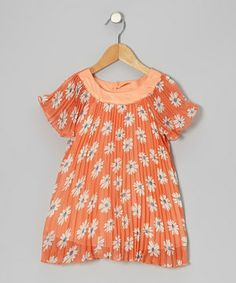 Flouncing with all the fun of being young, this stylish top combines a pretty print with fluttery pleats and a satin-covered neckline. A relaxed cut and buttons in back mean it's as comfy as it is charming.