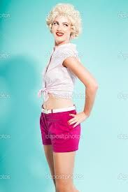 Google Afbeeldingen resultaat voor http://static9.depositphotos.com/1550494/1219/i/950/depositphotos_12194953-Sexy-blonde-pin-up-girl-wearing-pink-shirt-and-hot-pants.-Retro-style.-Fashion-studio-shot-isolated-on-light-blue-background..jpg