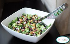 Love broccoli salad! I Use 1/2 cup fat free mayo & 1/2 cup plain Greek yogurt.  I use balsamic vinegar (& marinate my onions first w/ just enough to cover them), raw sugar or stevia, cranberries & sunflower seeds. I do not use fried greasy bacon, but will use real bacon crumbles if I have on hand. (50% less fat) ~lmr  :-)