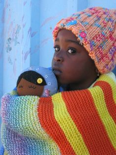 How can you help?  Visit our website at http://www.knit-a-square.com/  If you can make squares, please join us and help us warm more children.  Knit-a-Square South Africa is entirely funded by donations from people who care.  Non-knitters can enable us to carry on this important work and help us cover the costs of office space, transportation for distributions to the children etc. by making a financial donation through the PayPal link on our website.