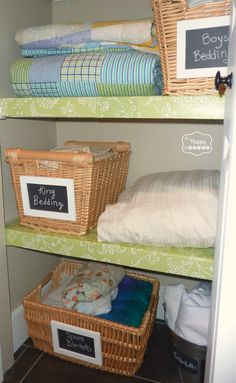 Use foam board and cover it with pretty contact paper to disguise basic wire shelves... make faux chalkboard labels for baskets using black foam board and thrift store painted frames... a newly organized Linen Closet at thehappyhousie